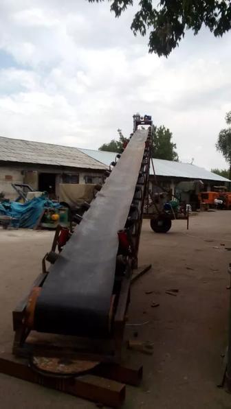 Ковшовые ленточные транспортеры приора упала на конвейере